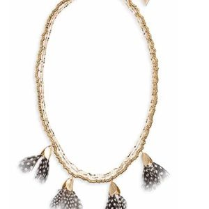 Serafina feather necklace with gold chain.